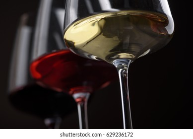Closeup of three glass of red, rose and white wine over black background. Wine card menu design. Wine list still life.