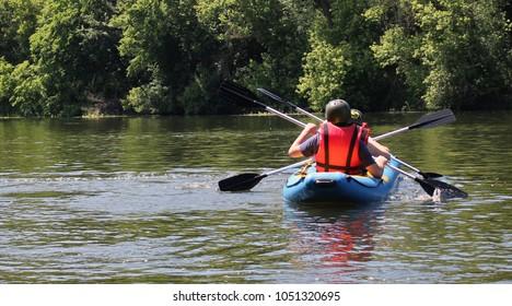 Close-up. Three  man  enjoy water rafting activity at river. Rafting family on holidays