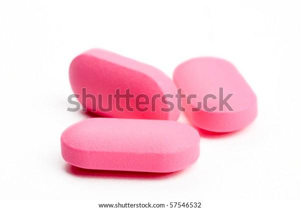 closeup of three pink pills