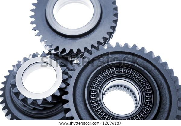 Closeup of three steel gears