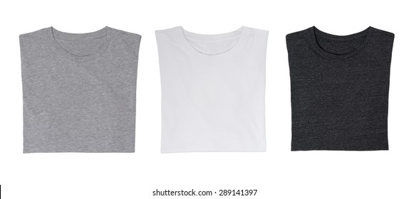 Close-up of the three t-shirts (black, white and grey). Isolated.