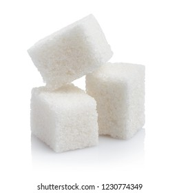 Close-up of three white sugar cubes, isolated on white background