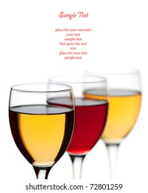 Closeup three wine glass isolated over white background and space for text  (soft focus)