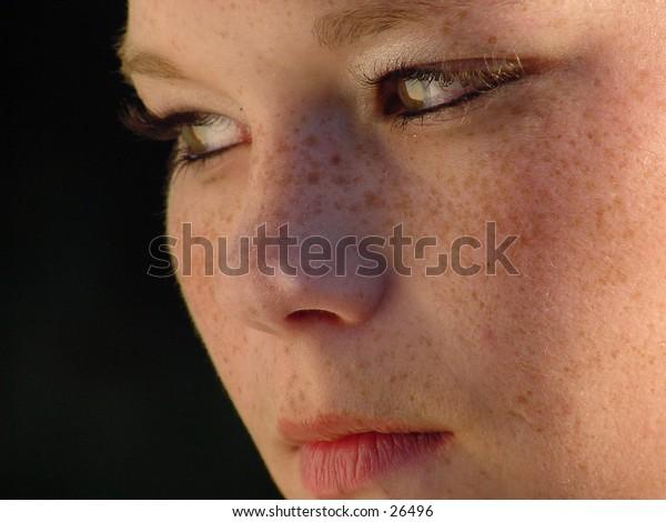 Close-up three-quarter view of girls; face soft light