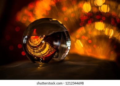 Closeup through a glass ball with abstract background