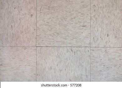 Closeup of tiled linoleum floor. Excellent as background for websites or as texture.