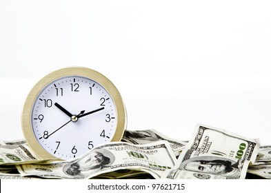 Close-up of time and money with white background
