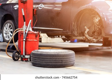 closeup tire and car parking repair garage with soft-focus in the background and over light