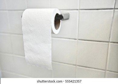 Close-up of tissue paper roll in bathroom