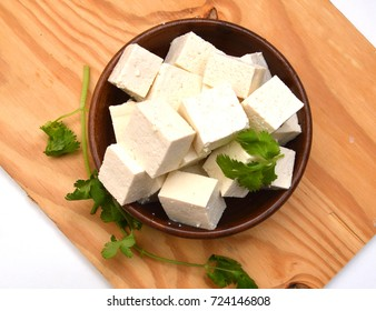 Closeup tofu isolated on wooden board on white background