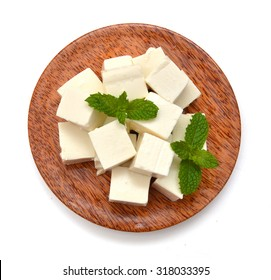 closeup tofu isolated in wooden bowl on white background