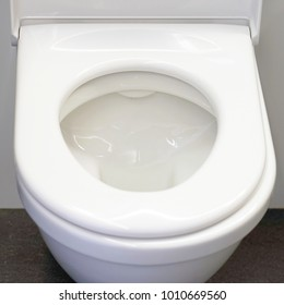 Close-up of toilet bowl. White toilet in the bathroom
