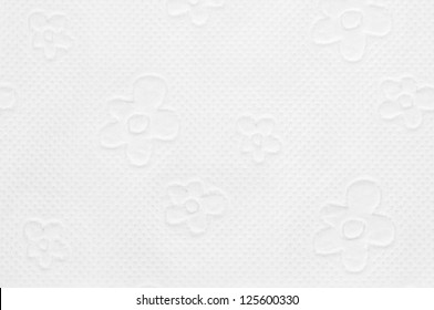Closeup of toilet paper with floral pattern