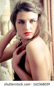 Closeup toned photo of naked woman with red lipstick