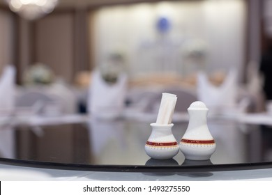 closeup of toothpick holder and pepper pot on Chinese dinner banquet table in a restaurant, selective focus.