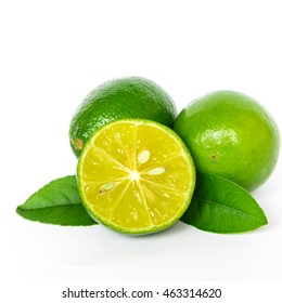 Close-up top view group of whole fresh picked green raw limes and leaves isolated on white background. Fresh Asian lemon cutout. Organic food concept with clipping path and copy space.