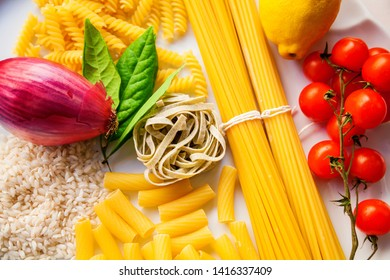 close-up top view italian food ingredients - pasta, rice, tomatoes