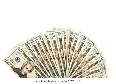 Close-up top view pile of 20$ bank notes in a fan shape isolated on white background. Twenty U.S. dollar Jackson collection for Business, finance, investment, saving, economics, corruption concept.