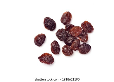 Close-up top view of Raisins isolated on white background.