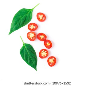 Closeup top view red chili pepper sliced with green leaf on white background, raw food ingredient concept