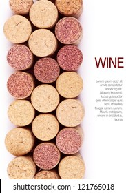 Closeup top view of wine corks over white background