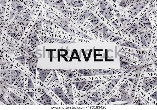Closeup torn pieces and tapes of paper with the word TRAVEL. Black and White image. Concepts of money and business.