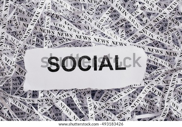 Closeup torn pieces and tapes of paper with the word SOCIAL. Black and White image. Concepts of money and business.