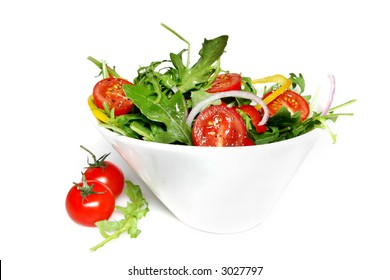 Closeup of tossed salad, in a white bowl.  Shallow focus.