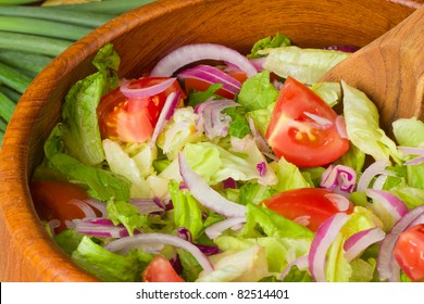 Close-up of tossed salad in a wooden bowl