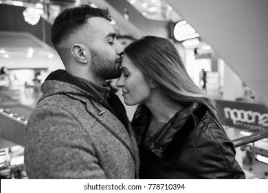 Close-up touching portrait of loving couple in bw. Sensual photo