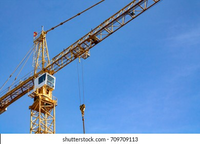 Closeup of a tower crane in a construction yard