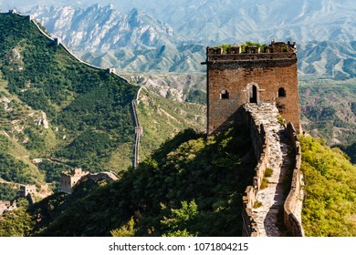 Closeup of tower entrance on Great Wall of China with mountainous  countryside in background