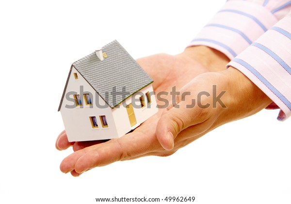 Close-up of toy house model in male hands