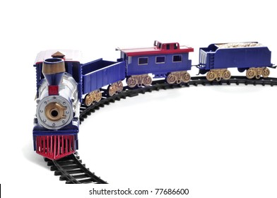 closeup of a toy train on a white background