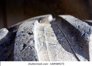 Close-up of tractor tyre texture detail. Background. Heavy machinery.