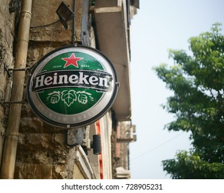 A closeup of the trademark brand logo of Heineken liquor company outside a pub/ restaurant, in Colaba causeway, Mumbai, Maharashtra, India. Shot in October 2017