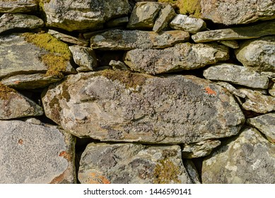 Closeup of a traditional British dry stone wall.  This type of wall is common in rural and mountainous areas across the United Kingdom.