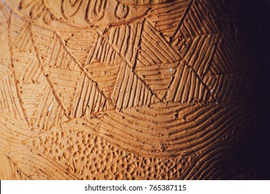 Close-up of traditional handcraft earthenware (Clay pottery) pattern background texture. Selective focus. Blurred background.