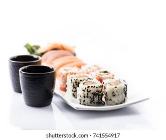 Closeup of traditional japanese sushi set with salmon and tuna fish isolated on white background. Sushi bar menu design with copyspace.