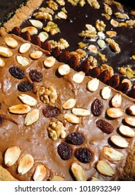 Close-up of the traditional Polish Easter mazurek cake decorated with dried fruit and nuts