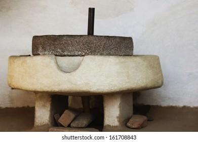 Close-up of a traditional stone grinder, Agra, Uttar Pradesh, India
