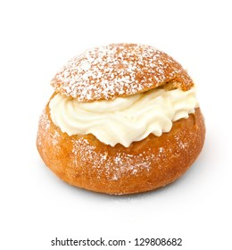 Close-up of traditional Swedish shrove bun (Semla) isolated on white background.