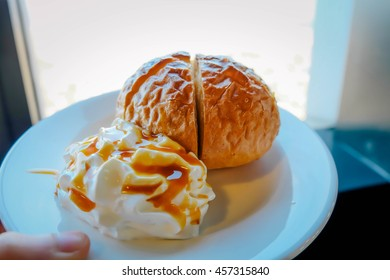 Close-up of traditional Swedish shrove bun with whipped cream