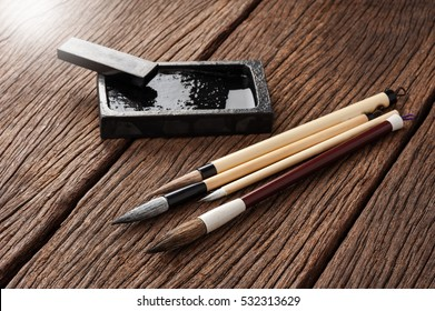 closeup traditional writing brush on wooden desk, Japanese writing brush, Chinese writing brush