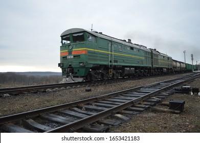 Closeup of a train locomotive on the railway.