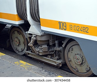 Close-up of tramcar wheels on tram in Bucharest, Romania