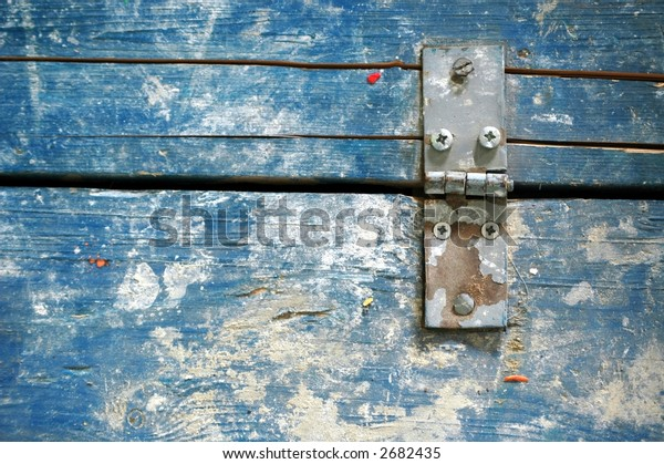 closeup of a trapdoor, old painted wood