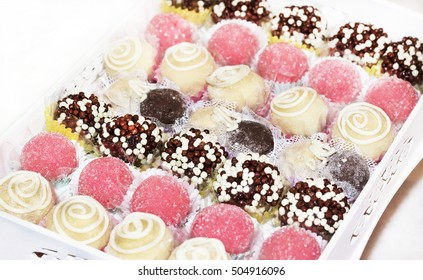 Close-up - tray of assorted sweets - chocolate, coconut, strawberry, brigadier and peanuts
