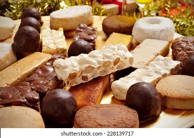 closeup of a tray with different turron, mantecados and polvorones, typical christmas sweets in Spain