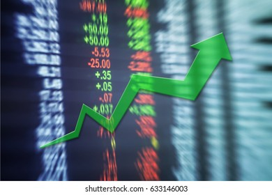 Closeup up trend arrow line chart on blurred stock board textured background in investment concept
